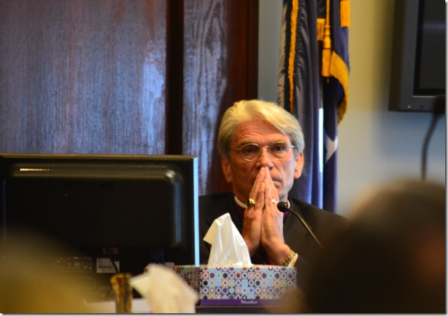 The Right Rev. Mark Lawrence of the Diocese of South Carolina listens as Judge Diane Schafer Goodstein decides whether Lawrence should be allowed to testify about procedures that were taken to remove him as a bishop of The Episcopal Church. (Photo/Ashley Barker)