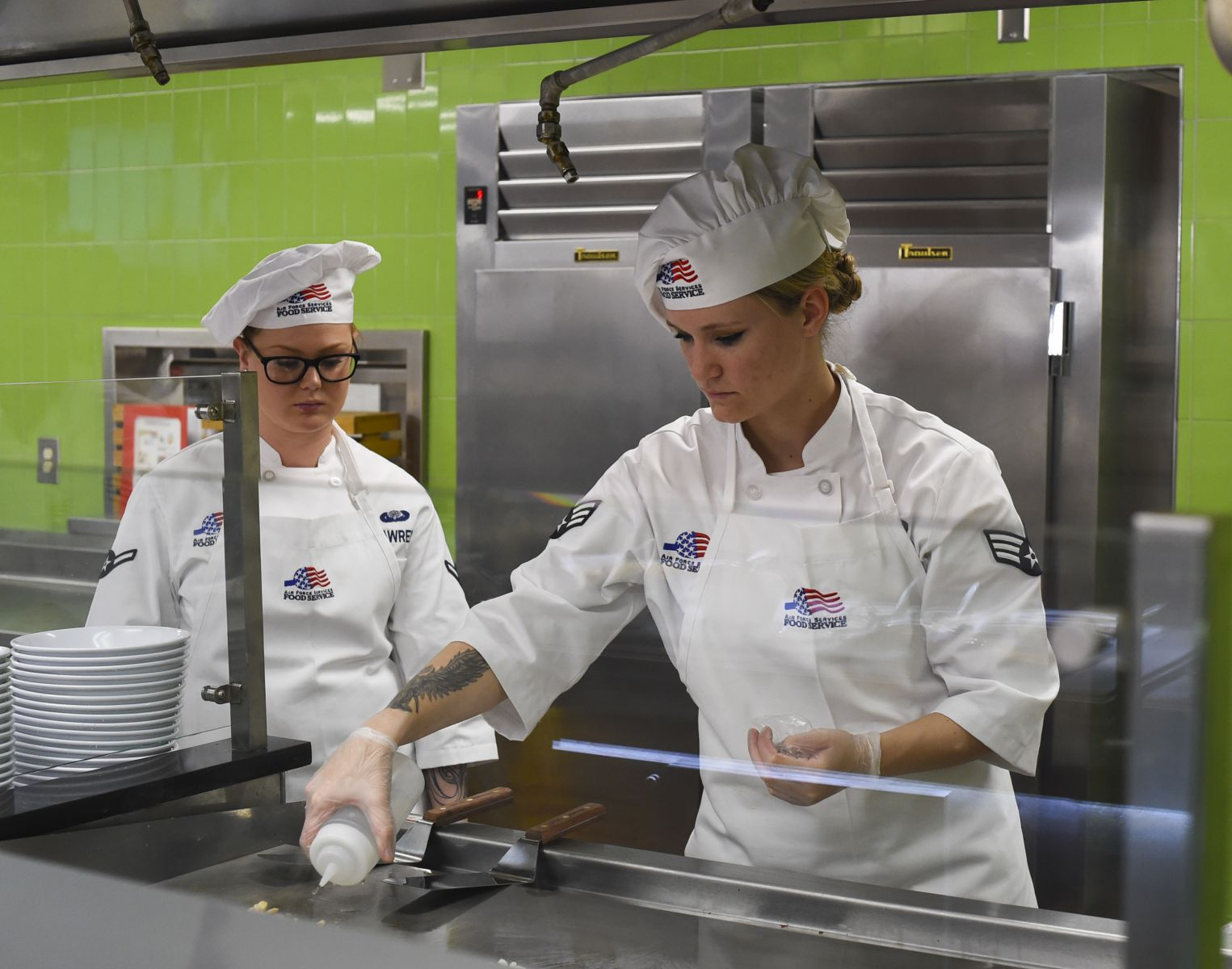 Food service workers serve patrons of Joint Base Charleston's newly renovated Gaylor Dining Facility. (Photo/Joint Base Charleston)