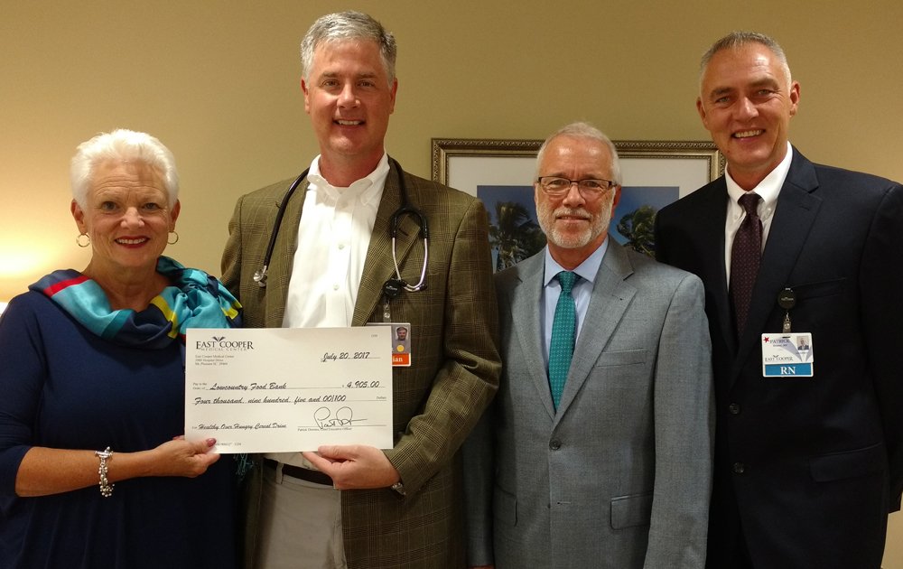 Lowcountry Food Bank CEO Pat Walker (from left); Dr. Matt Davis, chief of staff for East Cooper Medical Center; Danny Mullis, chairman of the board for East Cooper; and Chief Nursing Officer Patrick Beaver. (Photo/Provided)