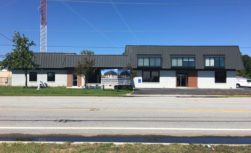 RCB Development bought the buildings at 4151 Spruill Ave., demolishing some and renovating the remaining ones into around 14,000 square feet of leasable, mixed-use commercial space. (Photo/Provided)