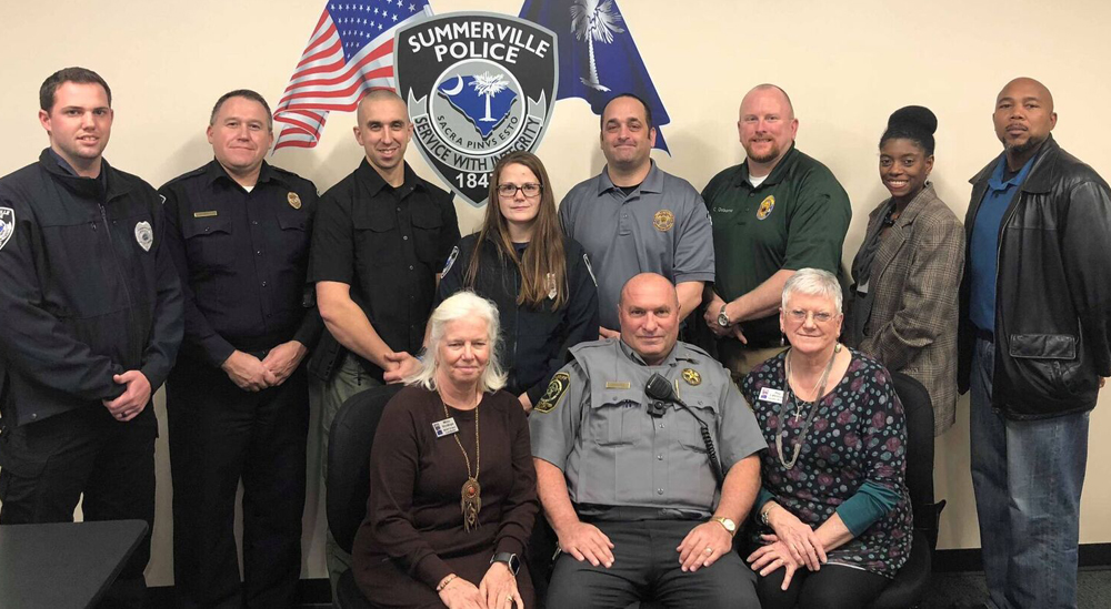 Pictured are Micky Styslinger (front row, from left), respite program director of The Ark of SC; George Karges, Dorchester County Sheriff's Office; Peg Lahmeyer, executive director of The Ark; and William Holmes (back row, from left), Sgt. Jason Forsythe, Leonard Vella and Amanda Huggins, all of Summerville Police Department; Nell White, Dorchester County Sheriff's Office; Charles Osborne, Mauldin Police Department; Naomi Cills, Noah project coordinator for The Ark; and Marcius Atkinson of Mauldin Police Department. (Photo/Provided)