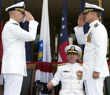 Cmdr. Brett Pugsley (right) takes command of Naval Consolidated Brig Charleston from Cmdr. J. Michael Cole, while Rear Adm. David Steindl, commander of Navy Personnel Command, observes during a ceremony Friday at Joint Base Charleston. (Photo/Air Force Staff Sgt. Jared Trimarchi)