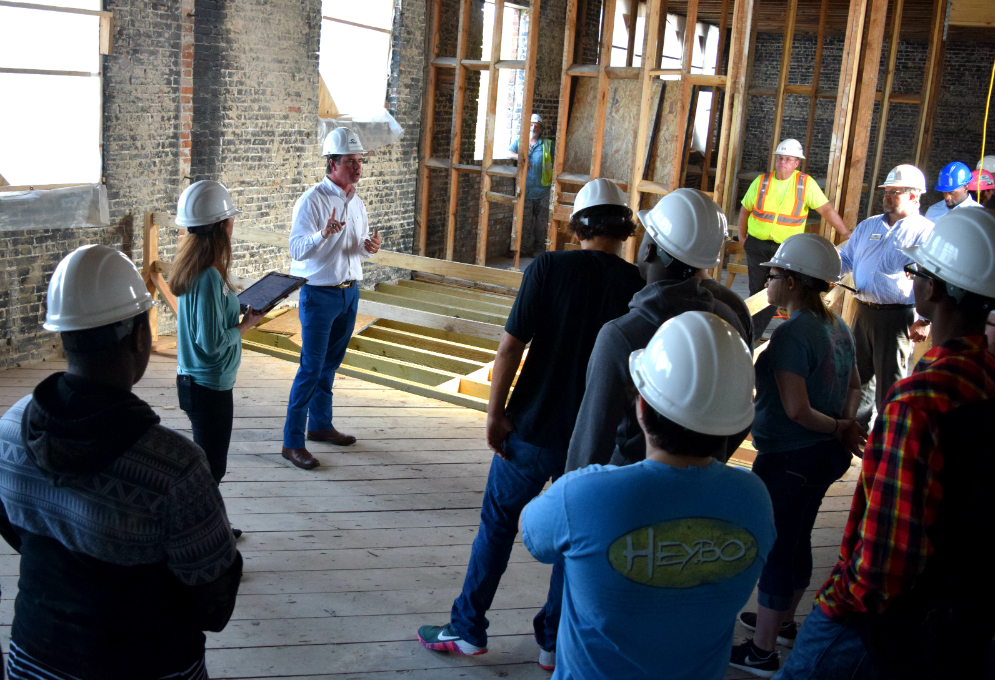 Contract Construction President Greg Hughes talks to Timberland High School students about various components of the renovation project underway at the old Berkeley High School building. (Photos/Ashley Heffernan)