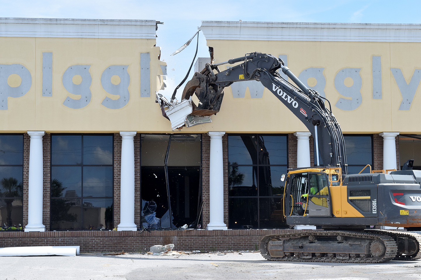 After Mayor Tecklenburg smashed one of the former grocery store's windows, Target Contractors began tearing down the former signage. After the demolition is complete, the city plans to hold public engagement sessions to learn what citizens want to see happen at the site. (Photo/Patrick Hoff)