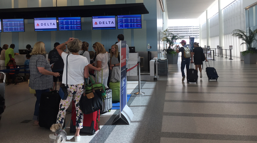 Airline ticketing counters at Charleston International Airport are now at capacity. Airport officials expect to expand the check-in area into the adjacent employee parking lot, providing additional counter space for future airlines and passengers. (Photo/Liz Segrist)
