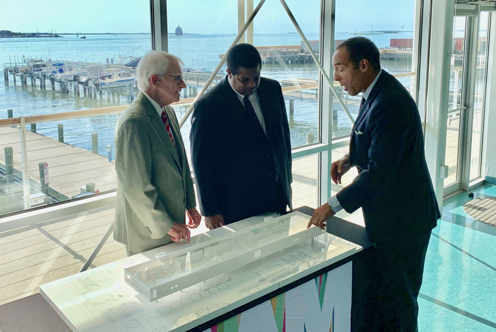 Former Charleston Mayor Joe Riley (from left); John Harvey, the manager of BP's Cooper River facility; and International African American Museum President and CEO Michael Boulware Moore discuss plans for the museum. (Photo/International African American Museum)