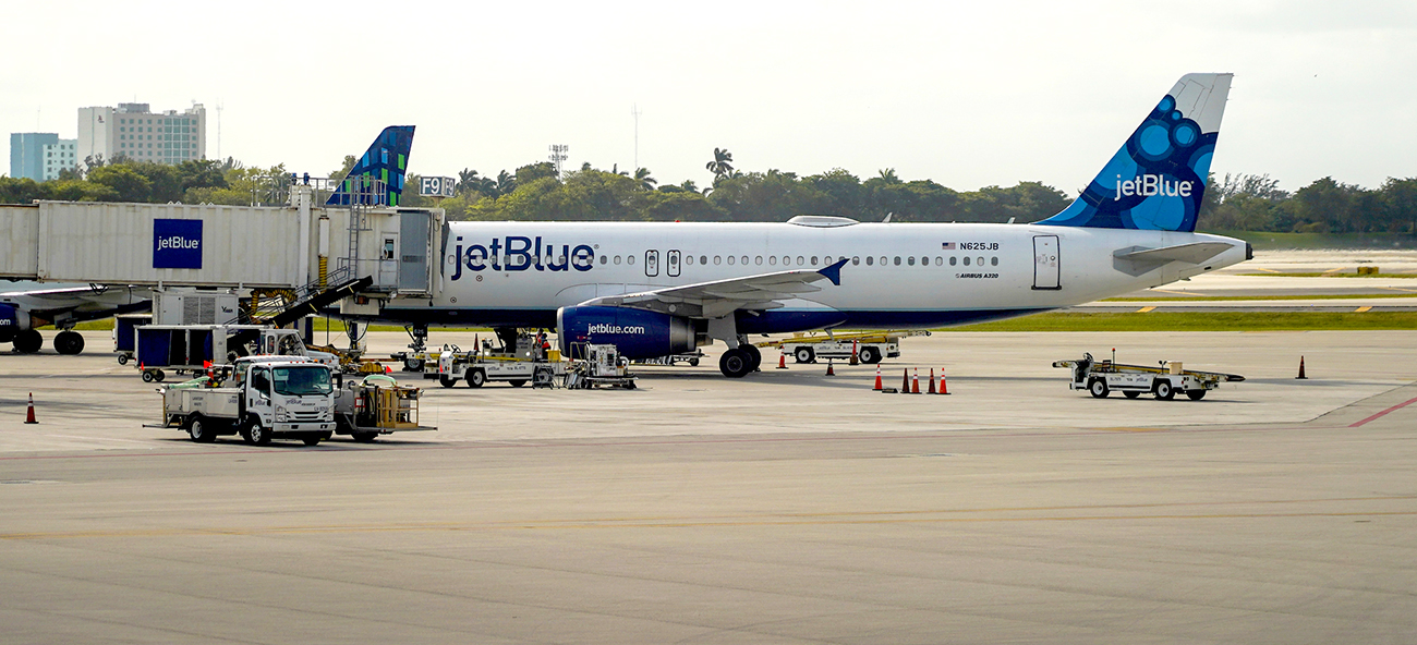 A JetBlue aircraft is parked on the tarmac in Fort Lauderdale, Fla., at Hollywood International Airport in December. (Photo/File)