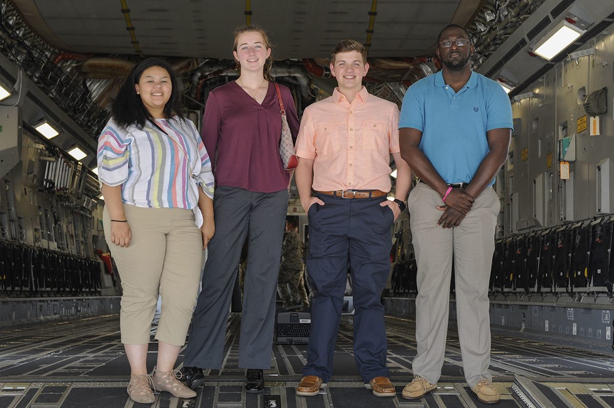From left, Summer interns Rachel Higgins, Emma McBride, Aleric Stell and Brandon Harvey stand on the ramp of a C-17 Globemaster III during a tour of Joint Base Charleston earlier this month. (Photo/Senior Airman Thomas T. Charlton for the Air Force)