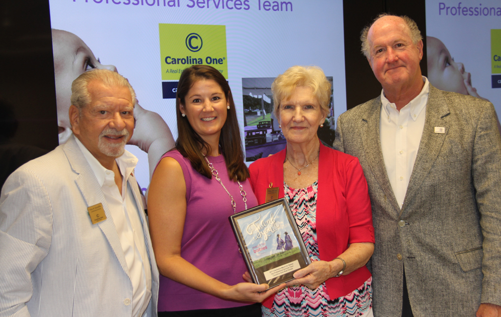 Vito Scarafile (from left), Carolina One volunteer coordinator; Erin Herrmann, executive director of Southeast S.C. March of Dimes; Millie Martin representing the Carolina One Orleans Road office; and Oliver Mathewes, Carolina One Realtor and top three fundraiser. (Photo/Provided)