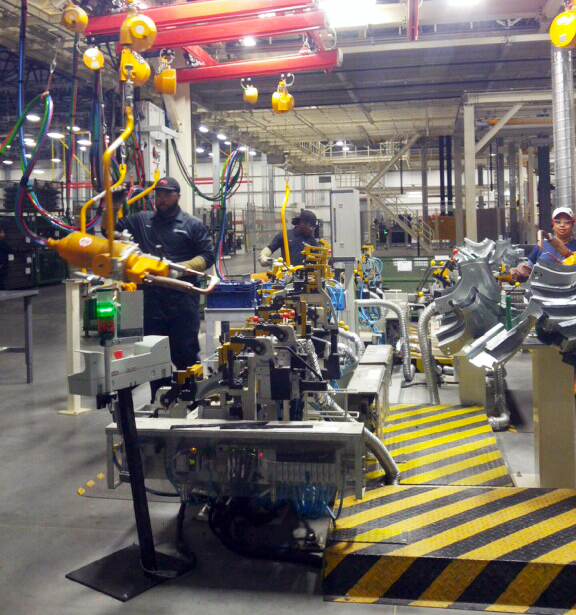 Employees work in the body shop at the Mercedes-Benz Vans campus in Ladson. (Photo/Kim McManus)