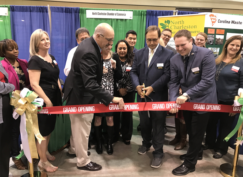 North Charleston Chamber of Commerce board Chairman Steve Nettles cuts a grand-opening ribbon during the North Charleston Business Expo. (Photo/Ashley Heffernan)
