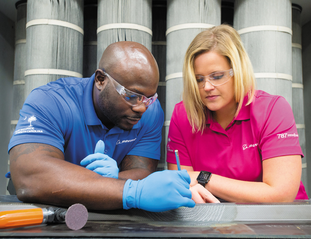 BR&T-SC teammates Phil Johnson and Megan Watson study composite repair plies while conducting 787 repair development research.