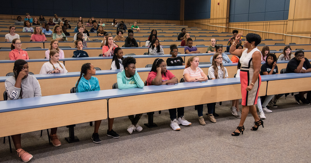Students attending the Girls Day Out camp attend presentations from professionals. (Photo/Joe Bullinger for the Navy)