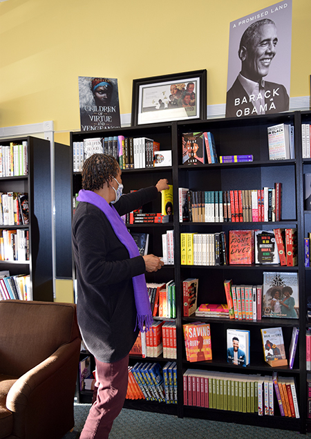 VaLinda Miller peruses the shelves of her bookshop in Goose Creek. A College of Charleston business school professor says she's part of a growing trend of women and Black entrepreneurs starting businesses at an increased rate. (Photo/Teri Errico Griffis)